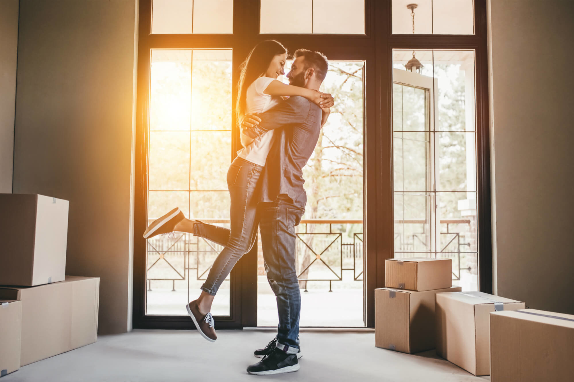 Young couple embrace after buying a new home